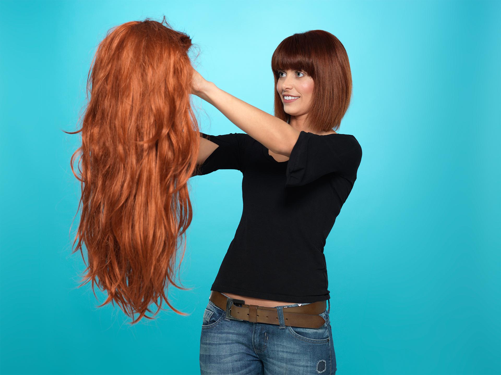 pretty woman admiring long hair wig